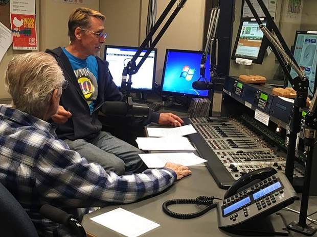Dave Olsen and broadcaster Eric Flaherty during Osen's final KVMR radio show on May 22.