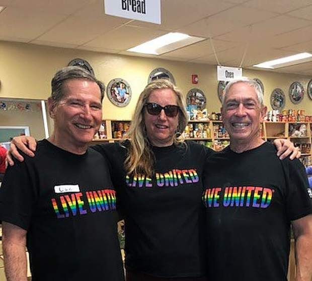 Luc Agosta with MeganTimpany, Executive Director of United Way, and Bud Sydenstricker helping out during Food Access Saturday.
