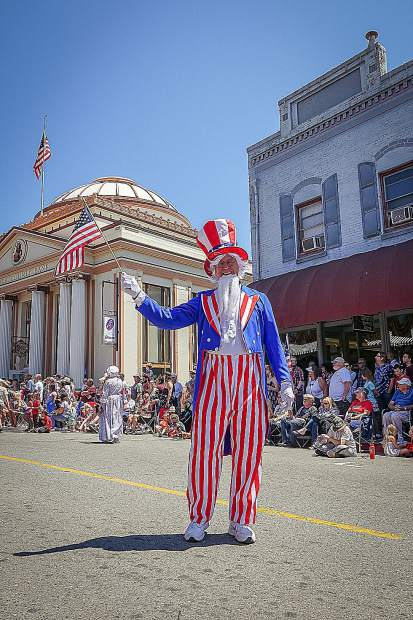 Uncle Sam and The Marching Presidents working the crowd on the 4th of July.