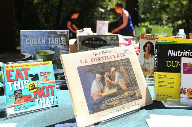 Librarians were able to sign folks up for library cards and even had some books available to check out during Saturday's Pop Up Library session at Pioneer Park. A Pop Up Library is scheduled once a month for different locations around the county. Saturday's Pop Up Library had a healthy food theme.