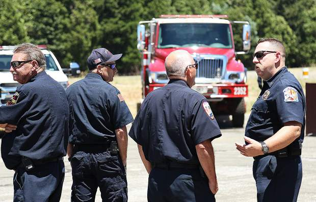 Area fire chiefs, captains and firefighters gathered at the Nevada County Airport and the Grass Valley Air Attack Base to be a part of the unveiling of the new red flag warning flag.