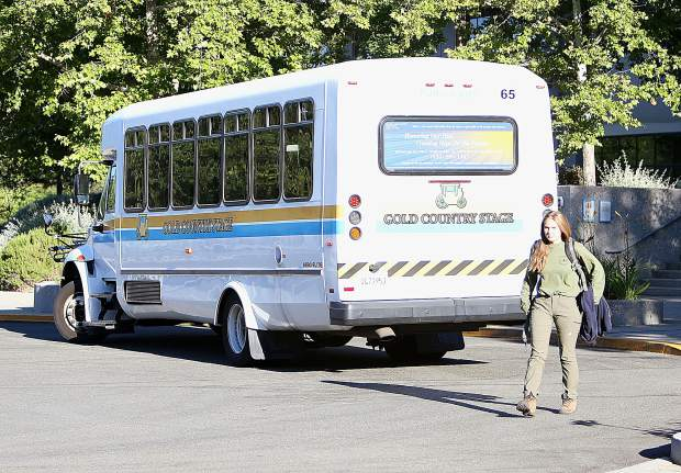 A bus rider gets off of Gold Country Stage's Route 7 at the Rood Government center after taking the bus from the San Juan Ridge Friday morning.