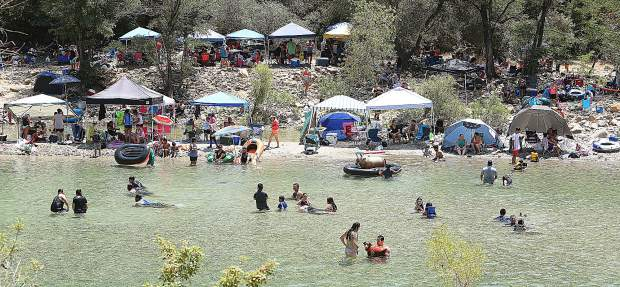 Thousands of people visit the South Yuba River State Park system in Nevada County each year. Now that river levels have subsided, more and more folks are flocking to places such as Kneebone Beach near the Bridgeport Bridge as seen Saturday.