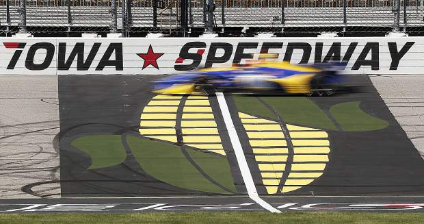 Alexander Rossi passes the finish line during practice for the IndyCar Series auto race last Friday at Iowa Speedway in Newton, Iowa. Rossi finished sixth in Saturday's race and now trails Josef Newgarden by 29 points in the overall point standings.