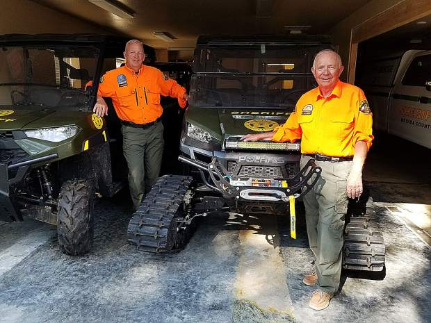 (Left to right) Jerry Weidler, Search and Rescue liaison, and Del Clement, volunteer coordinator, are ready for Saturday's fundraiser.