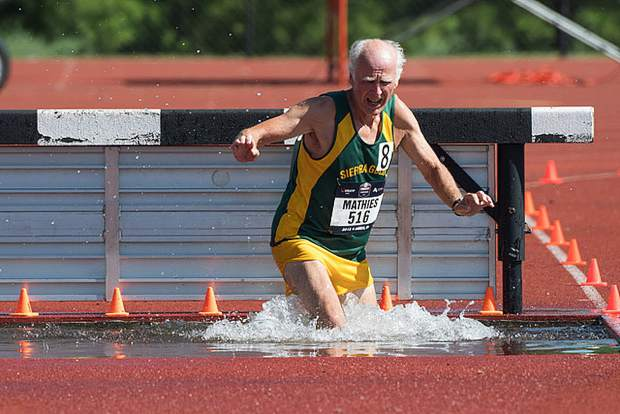 Sierra Gold athlete Drue Mathies competes in the steeplechase event at the USATF Outdoor World Championships in Ames, Iowa.