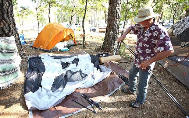 Penn Valley's Don Flint readies his tent alongside the other campers Thursday afternoon at the Nevada County Fairgrounds for the 2019 California WorldFest.
