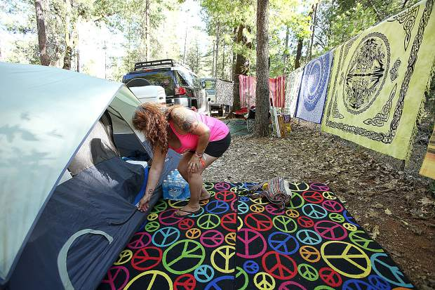 Grass Valley's Julie Lynch sets up camp in the woods of the Nevada County Fairgrounds before heading to the Meadow stage for the evening's opening WorldFest acts.