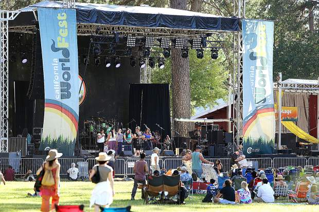 WorldFest'ers arrive at the Meadow Stage at the Nevada County Fairgrounds for the opening ceremonies of the event Thursday evening led by the Nevada City Rancheria Nisenan as well as representatives from other indigenous peoples.
