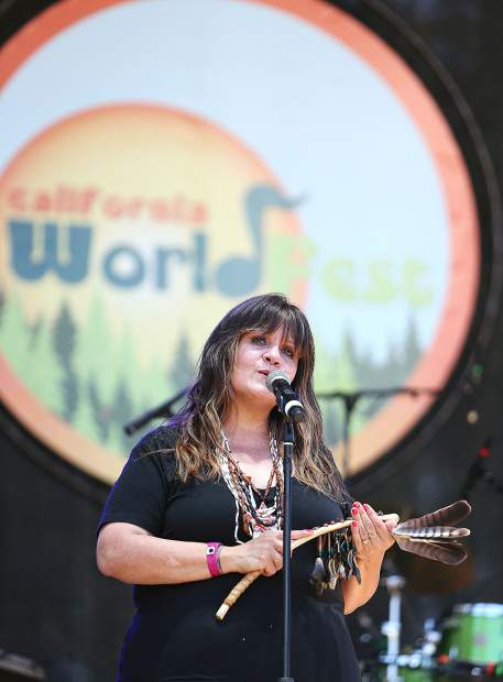 Shelly Covert of the Nevada City Rancheria Nisenan tribe welcomes those in attendance of Thursday afternoon's opening ceremony of California WorldFest at the Nevada County Fairgrounds. The annual event runs through Sunday featuring more than 40 bands and 100 performances.