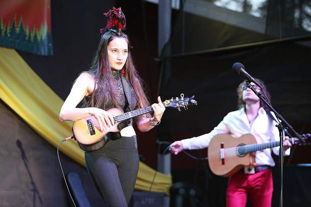 Members of the band Taimane play for the crowd on the Spotlight stage during Saturday evening's 2019 WorldFest lineup.