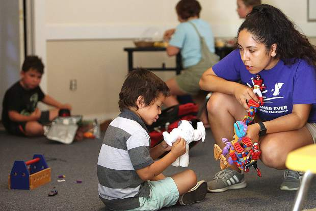 Youngster Kayden Mayen plays with senior camp counselor Angelica De La Torre Tuesday at Memorial Park. Kids age 5 to 12 are eligible for the summer day camp.