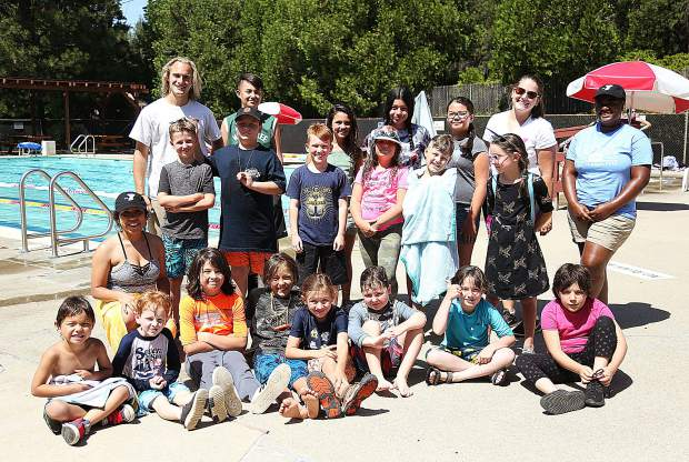 The kids and counselors of the YMCA Summer Camp smile after an afternoon in the Grass Valley swimming pool.