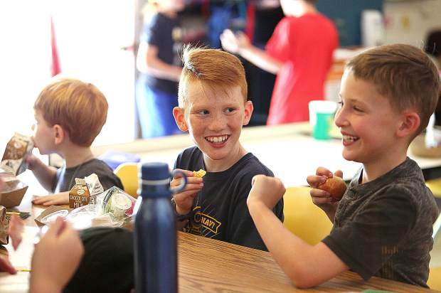 Grant Lacosse and Max Kontzer laugh as they eat their lunch Tuesday at Memorial Park in Grass Valley where the YMCA Summer Camp was in full swing.