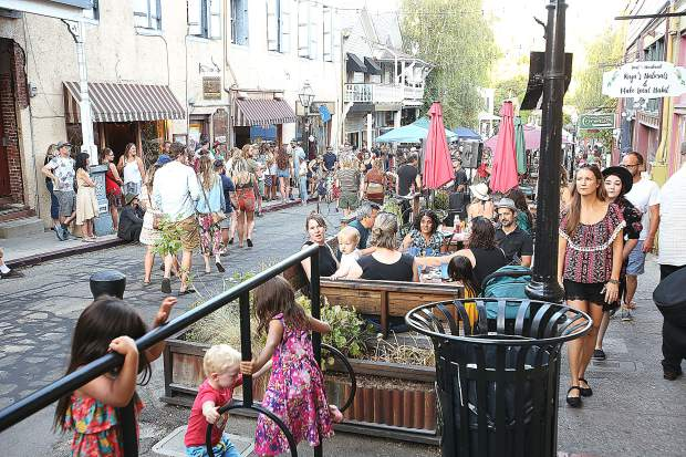 Commercial Street was blocked off to allow for foot traffic, vendor booths, and poetry readings during Friday's First Friday Art Walk in downtown Nevada City.