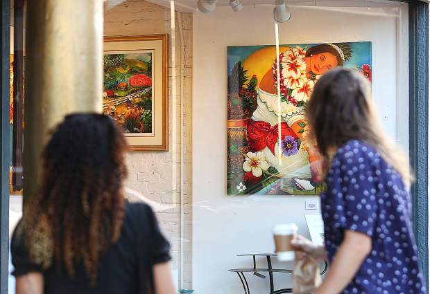 Artwork was abound around every corner in downtown Nevada City for the final First Friday Art Walk of the summer. Hundreds walked the streets admiring the work as well as purchasing art directly from artists who were on hand to help sell their craft.