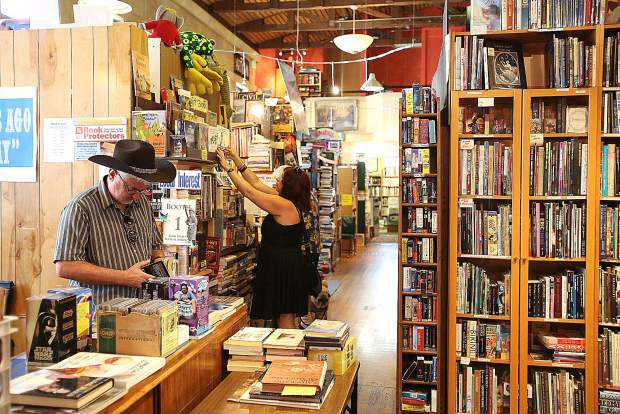 France's Nicolas and Eleanora Albin peruse through the collections of books at Booktown Books in downtown Grass Valley earlier this month.