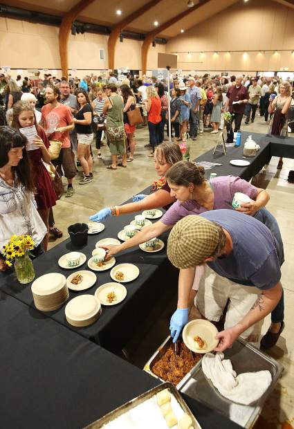 Folks wait in line for one of the many local food options available during the 7th annual Bounty of the County Wednesday at the Nevada County Fairgrounds.