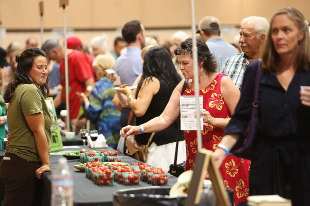 Nevada County Grown's Bounty of the County goers admire some of the cherry tomatoes made available by Mountain Bounty Farms during Wednesday's event at the Nevada County Fairgrounds.