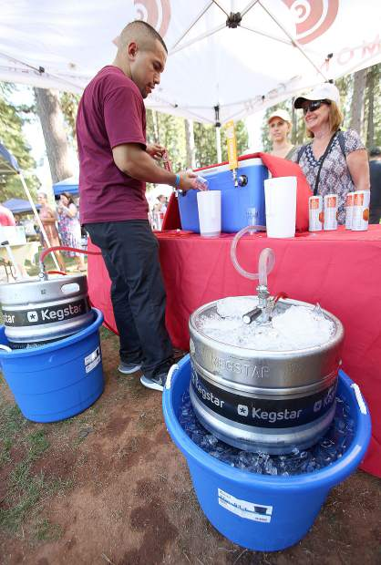 Zac Garza pours from a pair of Common Cider Kegs during Saturday's BrewFest.