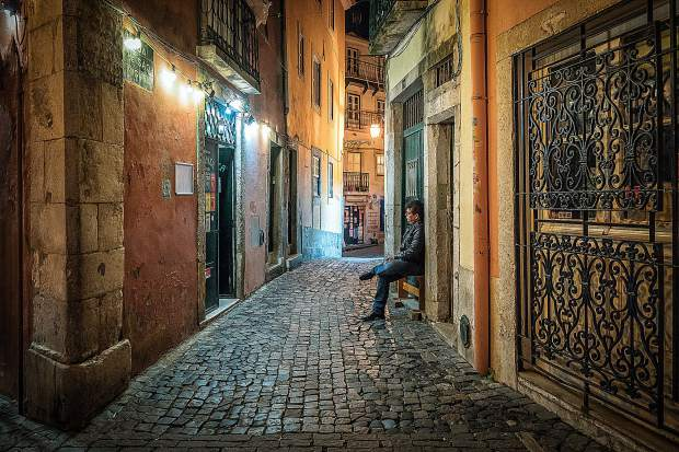 Her photo, Outside the Fado, Portugal, is an excellent example of technical acumen with perfect exposure given the challenging night lighting conditions.