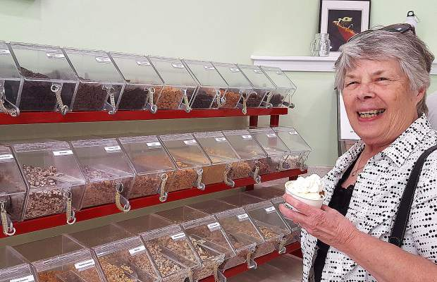 Cheryll Stowe smiles as she decides which of the dozens of toppings she wants on her frozen yogurt Wednesday. Stowe was at the Grass Valley Culture Shock with her husband, Don, and had nothing but praise for the store.