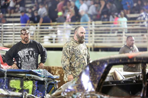 Grass Valley's Mark Heer listens for the results of the 2019 Nevada County Destruction Derby alongside the other drivers. Heer got 4th place and a $700 prize.