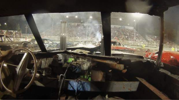 A driver's view of the destruction derby shows an arena littered with smashed cars and smoking engines on the final night of the Nevada County Fair Sunday evening.