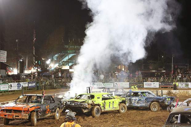 A radiator is blown sending steam into the air after a group of vehicles collide in the Nevada County Fair Arena during Sunday's destruction derby.