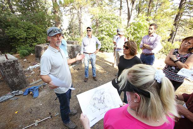 Warren Hughes shows off the former mining area located on the proposed Dorsey Marketplace and housing project during a June walking tour of the site in this archive photo.