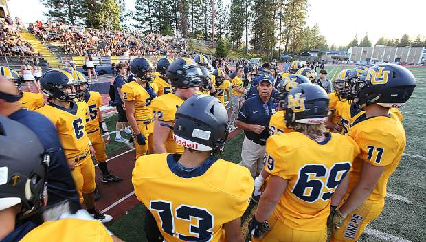 Nevada Union coaches and players ready to take the field for the opening game of the 2019 football season.