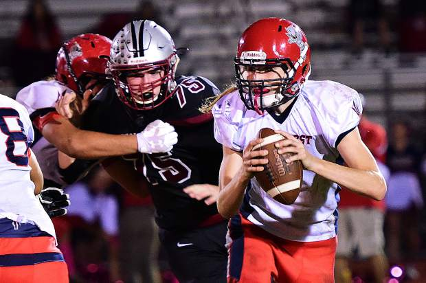 Bear River's Warren Davis closes in on Lindhurst's quarterback during a game last season. Davis is back with the Bruins for his junior season.
