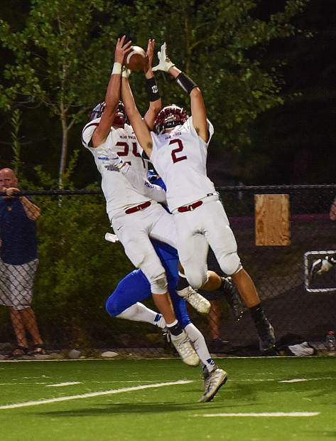 Bear River' defensive backs Tre Maronic (24) and Colton Jenkins (2) go up for a errant pass during the Bruins win over South Tahoe last season.