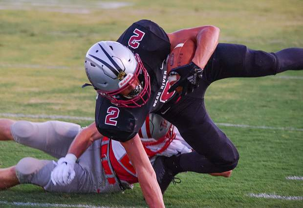 Bear River's Colton Jenkins fights for extra yards during a game against Truckee Friday night.