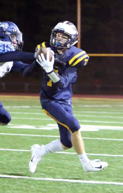 Nevada Union's A.J. Meyer huals in a pass during a game last season. Meyer is back for his third year of varsity football.