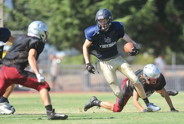 Nevada Union senior Ty Daugherty looks to fend off a Bear River defender during Saturday's scrimmage against the Bruins.