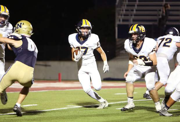 Nevada Union wide receiver Ben Taylor (17) carries the ball for the Miners during first half game play against the Napa Grizzlies.