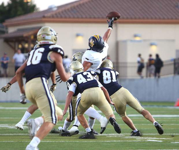 Nevada Union's Matthew Dal Bon (7) almost comes down with a pass during Friday's game against the Napa Grizzlies.