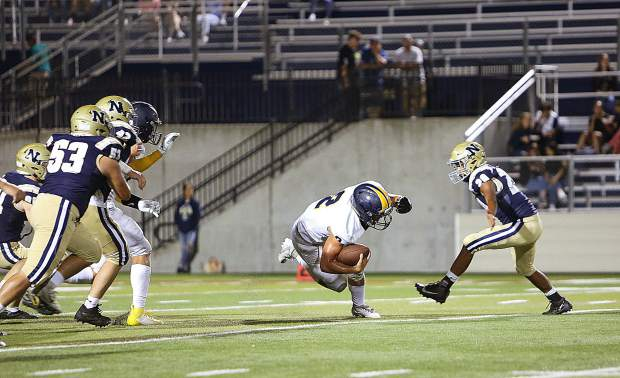 Backup quarterback Gabriel Baker (2) picks up some yards with a quarterback keeper during the Miners' win over the Napa Grizzlies.