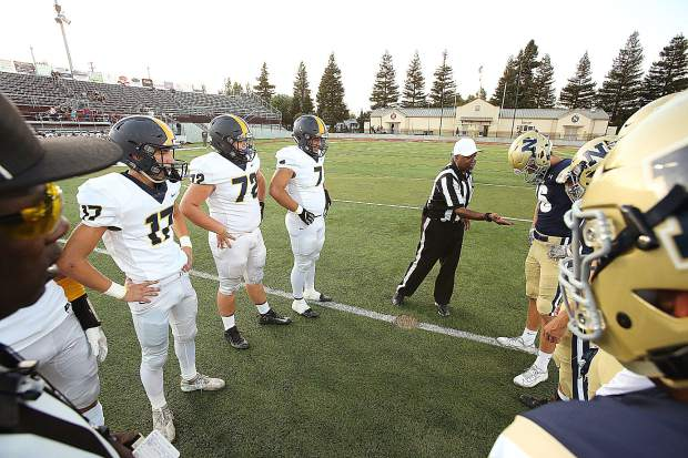 The Miners win the coin toss at the beginning of Friday's game against the Napa Grizzlies.