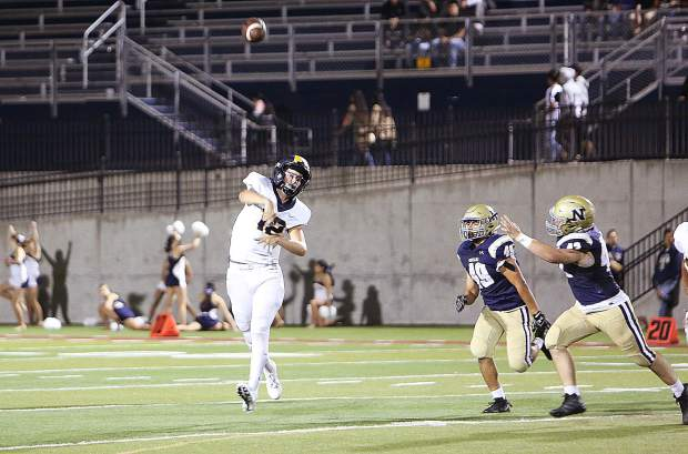 Nevada Union quarterback JT Conway (12) lets a pass fly during first half game play against the Napa Grizzlies Friday night at Napa.