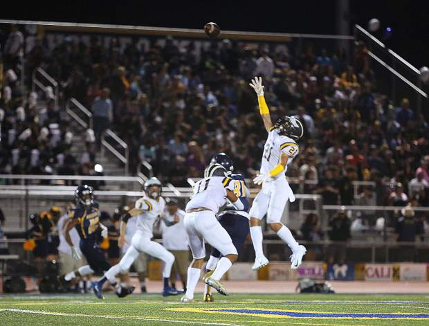 Nevada Union sophomore Jaxon Horne (21) intercepts the ball during a game against River City last season. Horne led teh Miners in interceptions as a sophomore and earned 2018 All-Foothill Valley League Second Team honors as a safety.
