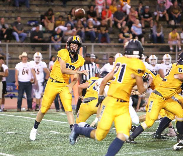 Nevada Union starting quarterback JT Conway passes to teammate Jaxon Horne.
