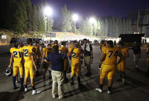 The Varsity Nevada Union Miners gather outside of their locker room during the half.