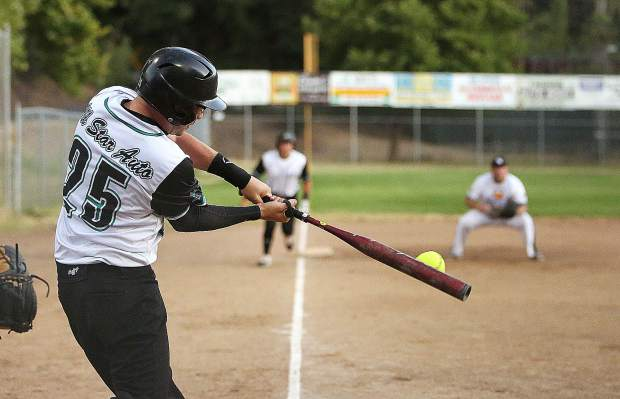 All Star Auto's Russell Brackett rips an RBI double in the first inning of the Nevada County Fastpitch Softball Championship Game Thursday night at Memorial Park in Grass Valley.