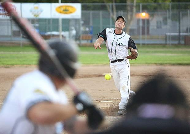 All Star Automotive's Mike Milligan pitched all seven innings, helping his team beat Long's Bottle Shop, 9-8, in Nevada County Fastpitch Softball Championship Game Thursday night at Memorial Park in Grass Valley.