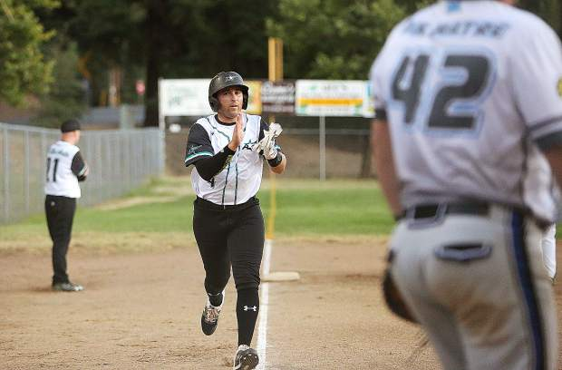 All Star Auto's Dylan Hadley trots home during the first inning of the Nevada County Fastpitch Softball Championship Game Thursday night at Memorial Park in Grass Valley.