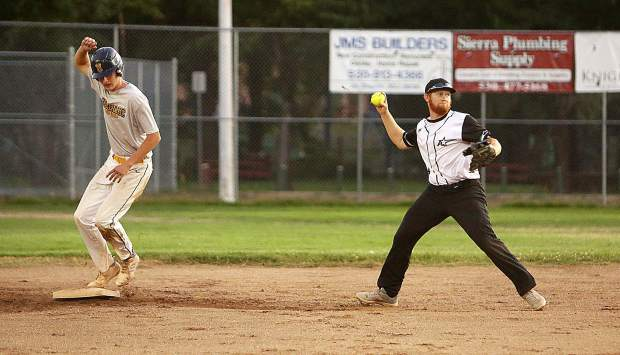 All Star Auto second baseman Hadley ousts Longs Bottle Shop designated runner Matthew TIntle and prepares to make the throw to 1st.
