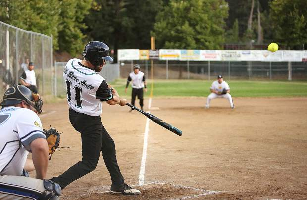 All Star Auto's Brandon O'Callaghan hits a triple to the right field fence during the Nevada County Fastpitch Softball Championship Game Thursday night at Memorial Park in Grass Valley.