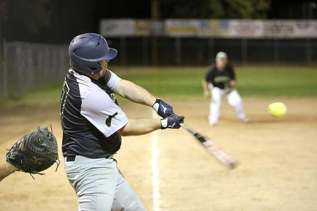 All Star Automotive B Team batter Joey Mackey puts the ball into play during Thursday evening's playoff loss to the Oroville Dirt Bags.